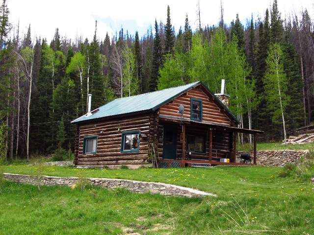 The Cottonwood Cabin Living Room - Picture of The Old Mill ...  Old Log Cabins Wyoming
